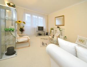 Posezení v ubytování White Apartment