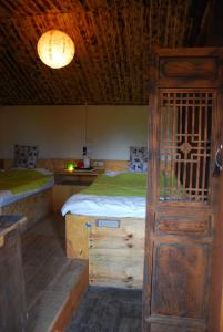 A bed or beds in a room at Shaxi Horse Pen 46 YHA