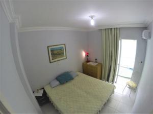 Cama ou camas em um quarto em Apartamento Bombas