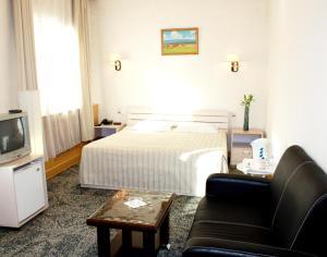 Cama o camas de una habitación en Voyage Hotel