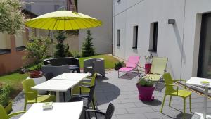 A restaurant or other place to eat at ibis Styles Montbéliard