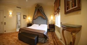 מיטה או מיטות בחדר ב-Hotel Villa Duse