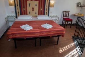 Ein Bett oder Betten in einem Zimmer der Unterkunft A Cà Da Nonna Di Callo Luca