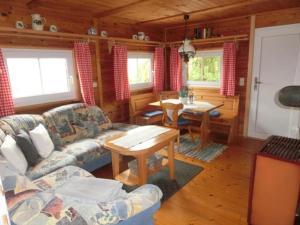 Ein Sitzbereich in der Unterkunft Ferienhaus Gustl