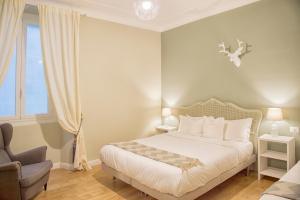 Letto o letti in una camera di La Piazzetta Rooms