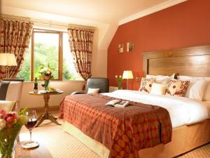 A bed or beds in a room at Glengarriff Park Hotel