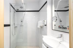 Ein Badezimmer in der Unterkunft I´m Inn Wieselburg