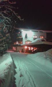 Gästehaus Bergland during the winter