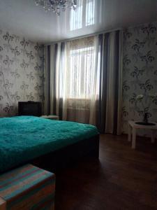 Кровать или кровати в номере Apartments at Krasniy Prospekt 3
