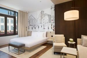 A bed or beds in a room at La Ville Hotel & Suites CITY WALK Dubai, Autograph Collection
