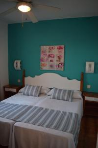 A bed or beds in a room at Apartamentos Castell Sol