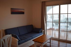 A seating area at Apartamentos Castell Sol