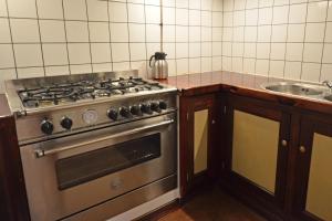 Een keuken of kitchenette bij Sudermar