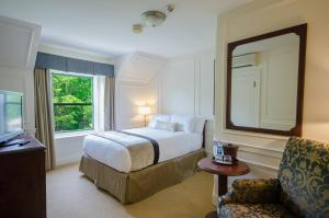A bed or beds in a room at Digby Pines Golf Resort and Spa