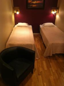 Säng eller sängar i ett rum på Vanadis Hotell & Bad