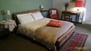 Letto o letti in una camera di B&B del Borgo