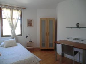Cama o camas de una habitación en El Artista