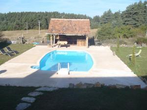 A view of the pool at Gite du Domaine de Bombes or nearby