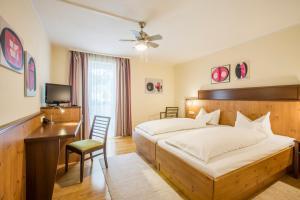 Ein Bett oder Betten in einem Zimmer der Unterkunft Hotel Brunner