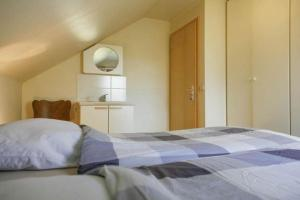 A bed or beds in a room at Val du Roannay