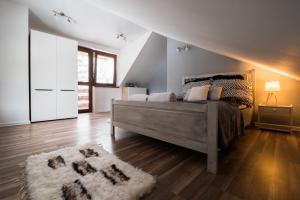 Łóżko lub łóżka w pokoju w obiekcie JosepHome