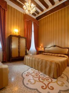 Letto o letti in una camera di Centauro Hotel