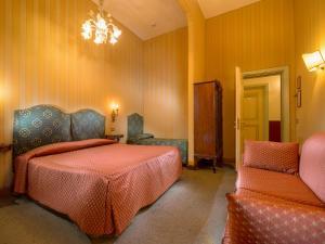 Cama o camas de una habitación en Centauro Hotel