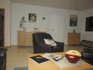 Ein Sitzbereich in der Unterkunft Ferienwohnung Kaiser