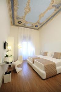 Letto o letti in una camera di Al Castello Luxury B&B