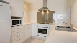 A kitchen or kitchenette at Beach House Seaside Resort