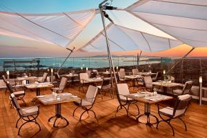 A restaurant or other place to eat at Divan Istanbul Asia