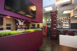 Телевизор и/или развлекательный центр в Отель Пегас