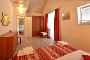 Postel nebo postele na pokoji v ubytování Apartment Ivka