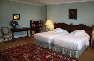 A bed or beds in a room at Mihotelito