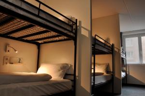 A bunk bed or bunk beds in a room at The ASH