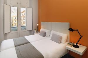 A bed or beds in a room at iloftmalaga Apartamentos Calle Larios