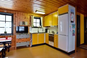 A kitchen or kitchenette at Holiday Home Långberget