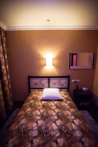 Кровать или кровати в номере Almaz Hotel