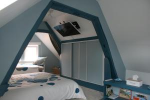 Un ou plusieurs lits dans un hébergement de l'établissement Gîte à la Ferme des Rooses