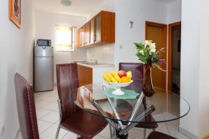 A kitchen or kitchenette at Meri Apartment