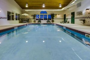 The swimming pool at or near Country Inn & Suites by Radisson, Stockton, IL