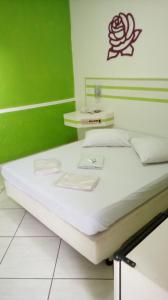 A bed or beds in a room at Motel Chateau (Adult Only)