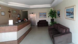 The lobby or reception area at Tropical Praia Hotel