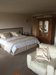A bed or beds in a room at Ackroyd House