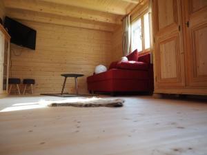 Ein Sitzbereich in der Unterkunft Ferienhaus Holzhaisl
