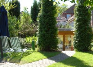 A garden outside Hotel Holst