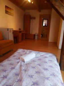 Postel nebo postele na pokoji v ubytování Penzion U Slunce