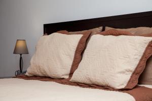 Uma cama ou camas num quarto em Hotel Vale do Zezere