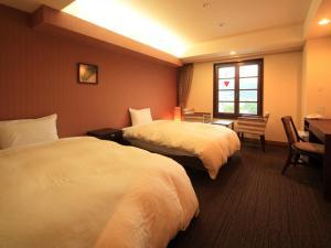Un ou plusieurs lits dans un hébergement de l'établissement Nikko Station Hotel Classic