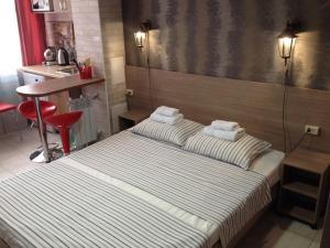 Кровать или кровати в номере Светлана